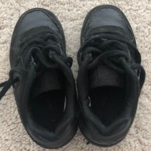 Black toddler Nike sneaker  uptown's